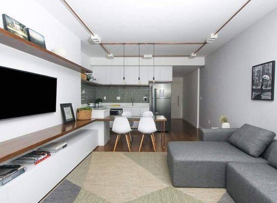 sala de jantar integrada com sala de estar e cozinha