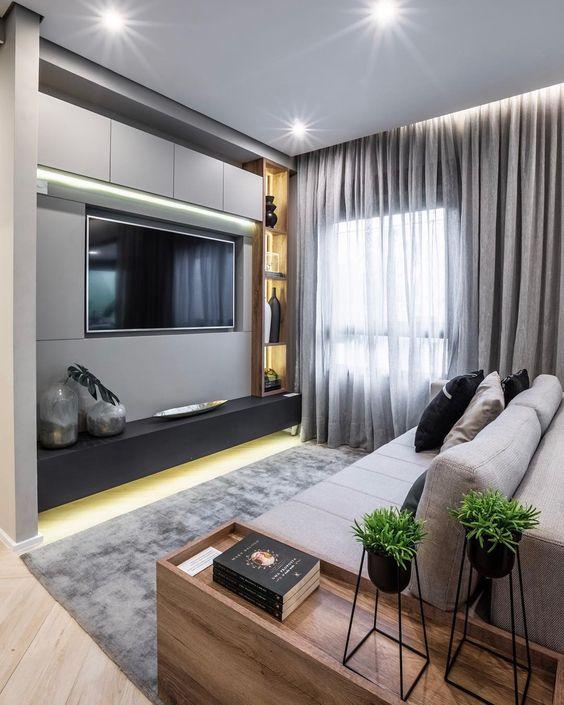 Sala planejada pequena com decoração cinza.
