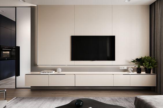 Sala minimalista com painel de tv branco e armário preso na parede.