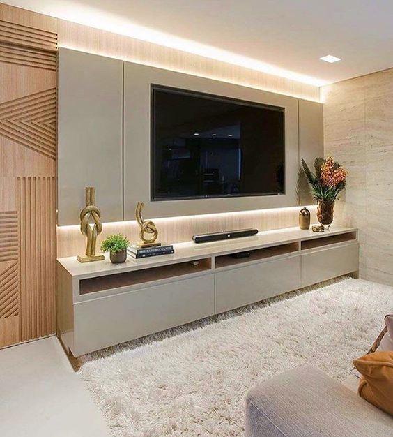Painel de tv em conjunto com o raque e tapete branco.