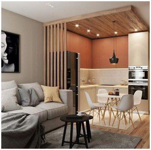 Cozinha com iluminação embutida no teto e uma luminária suspensa na mesa.