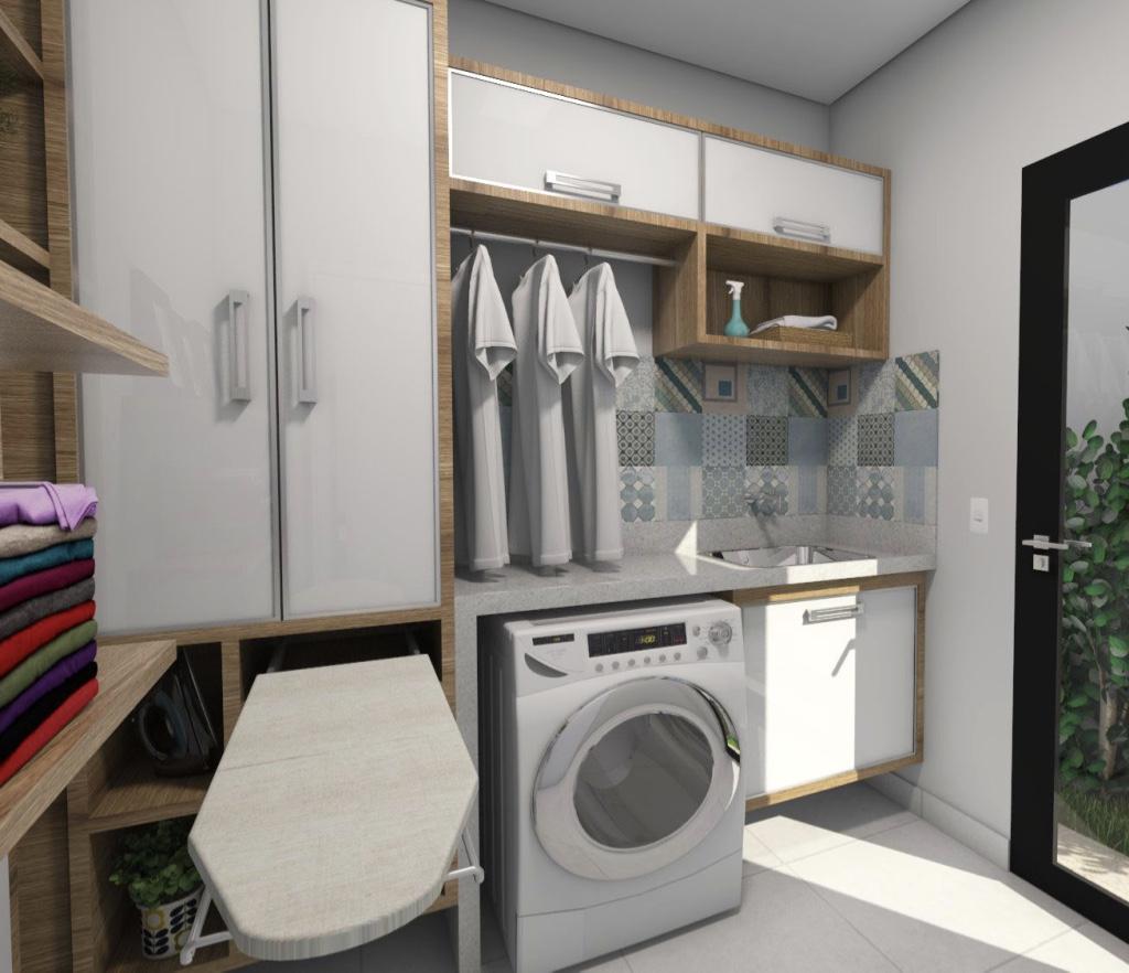 Área de serviço grande com armários brancos e de madeira.