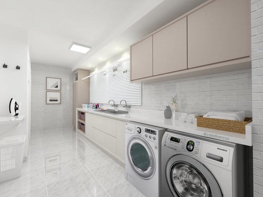 Decoração simples com cores neutras e duas máquinas de lavar.