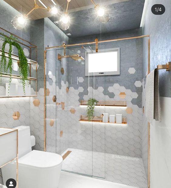 Decoração clean com azulejo hexagonal, metais dourados e cimento queimado.
