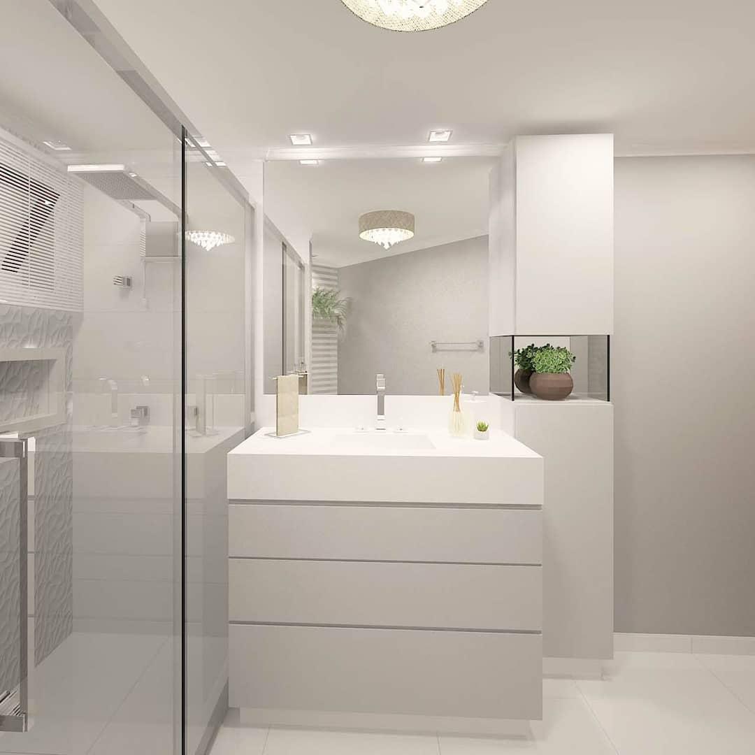 Decoração luxuoso com armário moderno e lustre pequeno.