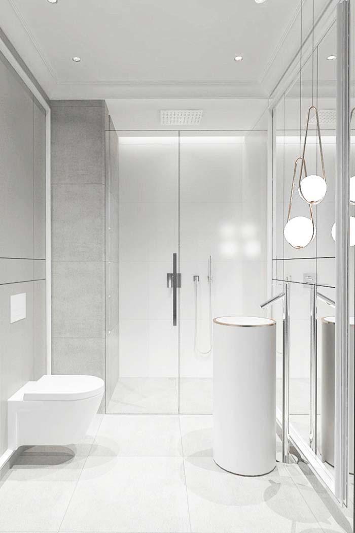 Banheiro branco moderno com vasos suspenso e pendente suspenso.