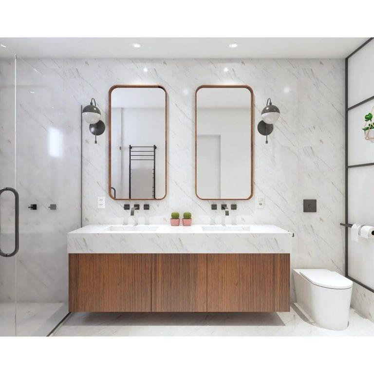 Banheiro branco luxuoso com armário de madeira.
