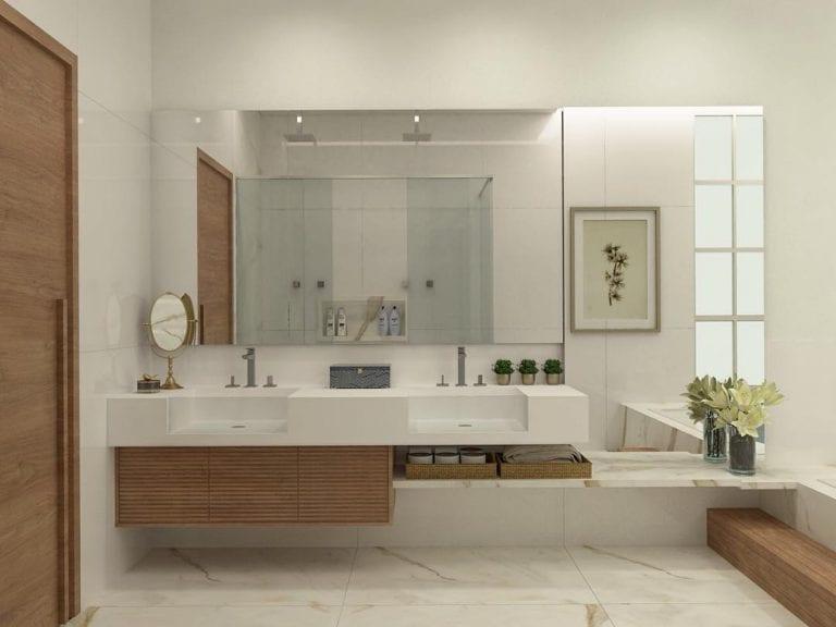 Banheiro branco moderno com armário de madeira e bancada dupla.