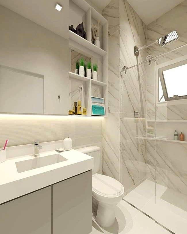 Banheiro branco com armário neutro e porcelanato.