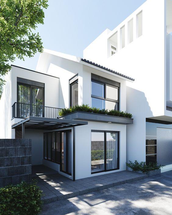 Casa pequena com fachada preta e branca.
