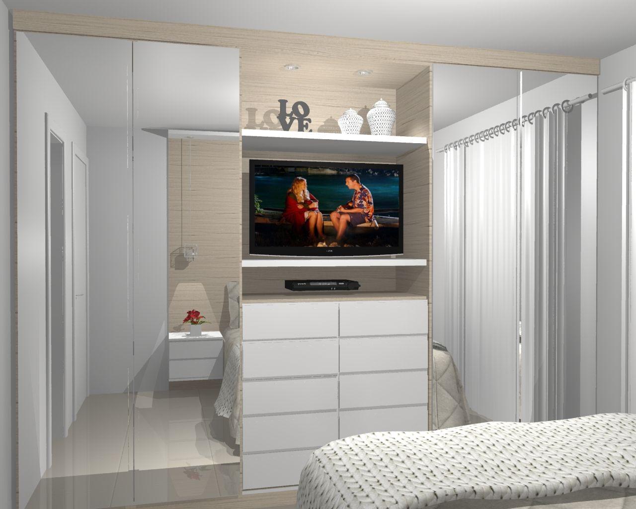 Guarda-roupa planejado branco com TV embutida.