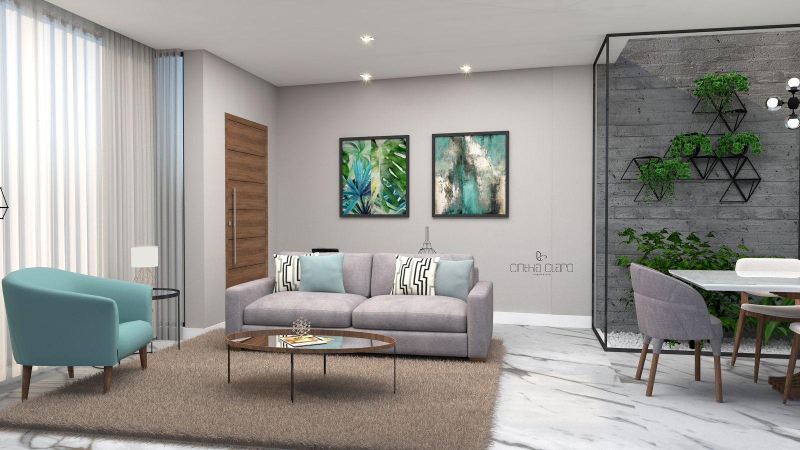 Decoração de sala de estar integrada com poltrona azul e sofá cinza.