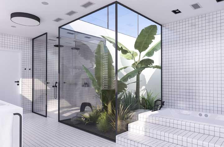 Banheiro moderno com banheiro, ducha e azulejo geométrico.