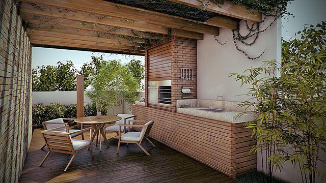 Varanda gourmet com piso de madeira e jardim.