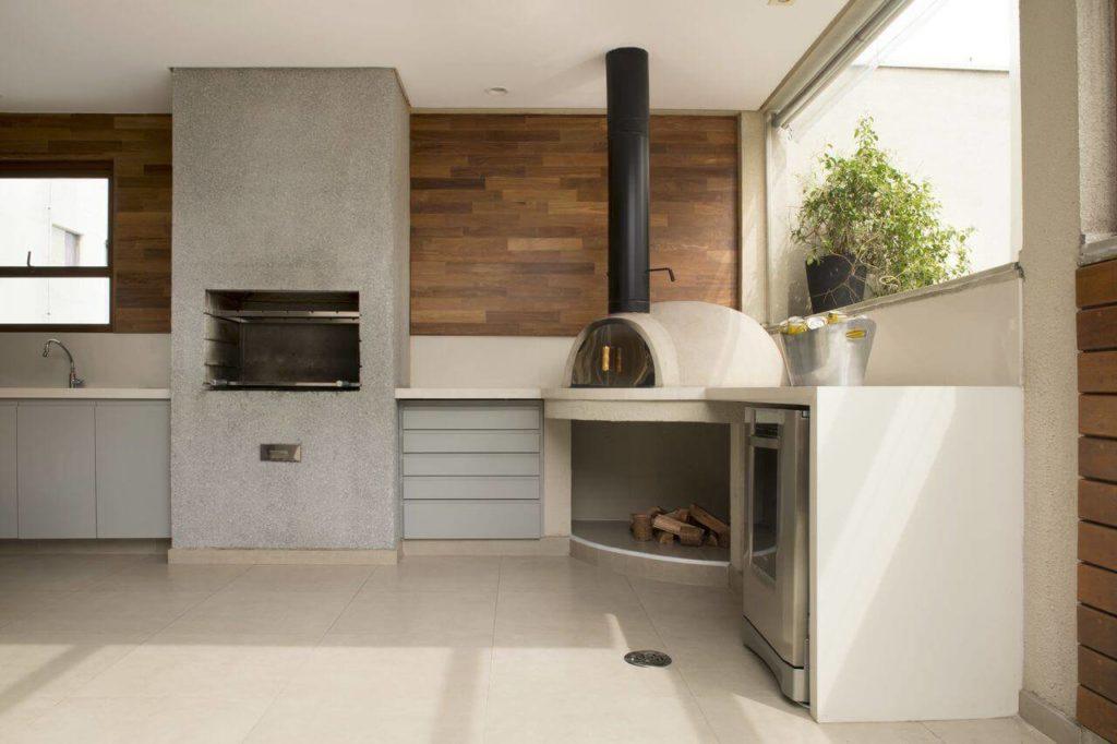 Modelo de churrasqueira de concreto e forno de pizza.
