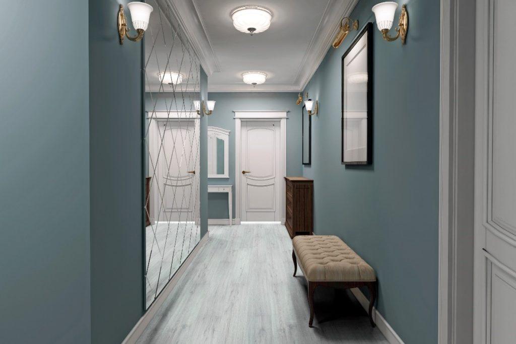 Corredor decorado com espelho e piso vinílico.