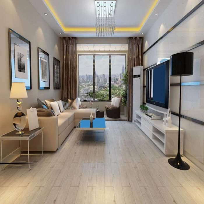 Sala pequena com sofá em L e decoração neutra.