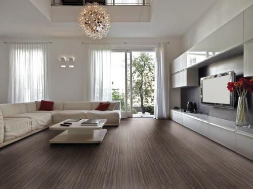 Sala simples grande com sofá em L.