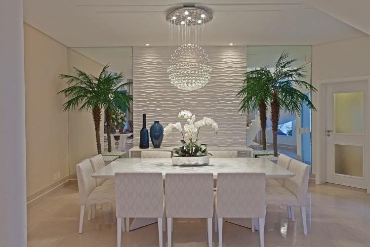 sala de jantar com parede de gesso
