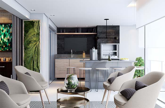 Varanda gourmet com decoração moderna e poltronas.