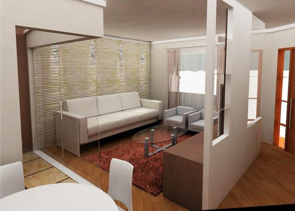 Sala pequena decorada com divisória de ambiente de vidro.