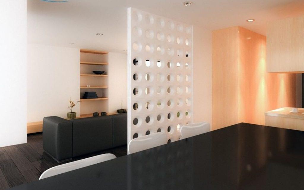 Salas separadas por parede de cobogó branca.