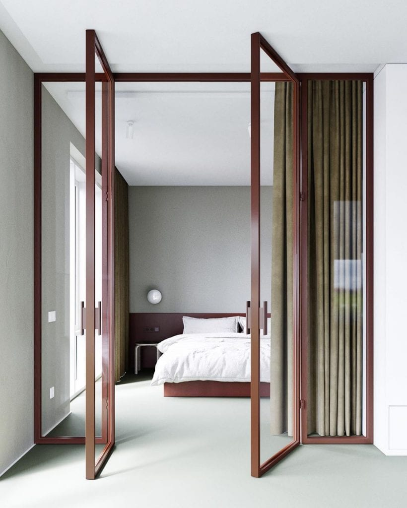 Quarto minimalista com porta de vidro.