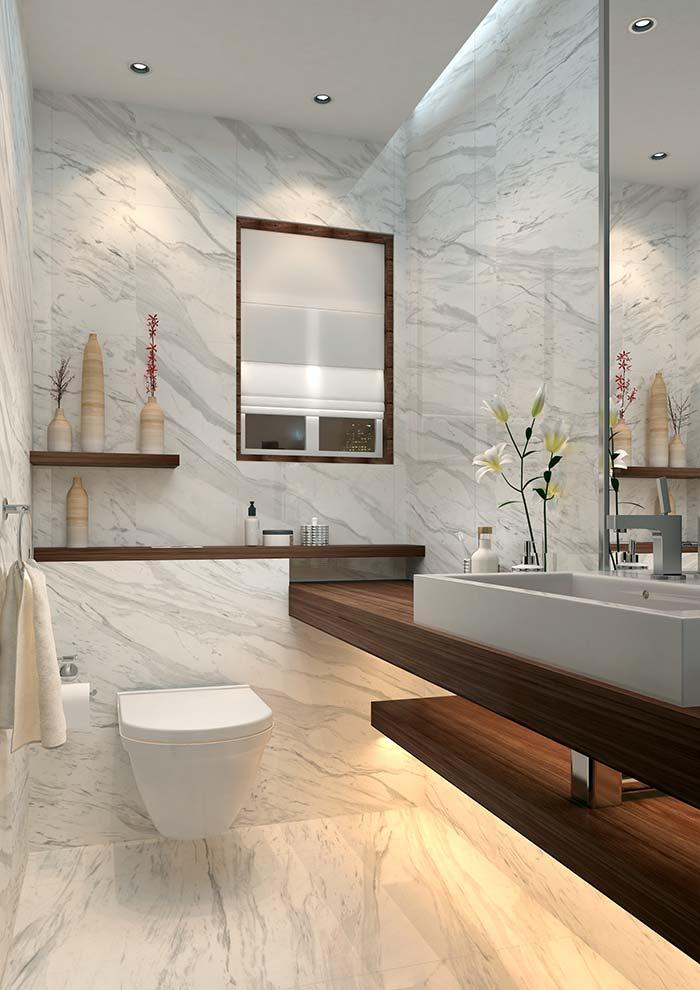 Lavabo elegante com vasos suspenso e revestimento de mármore branco calacatta.