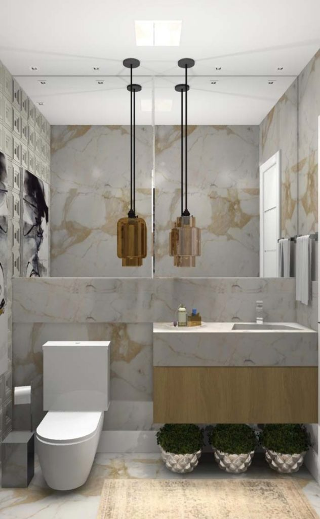 Lavabo pequeno e luxuoso com revestimento de mármore branco paraná com pia esculpida.