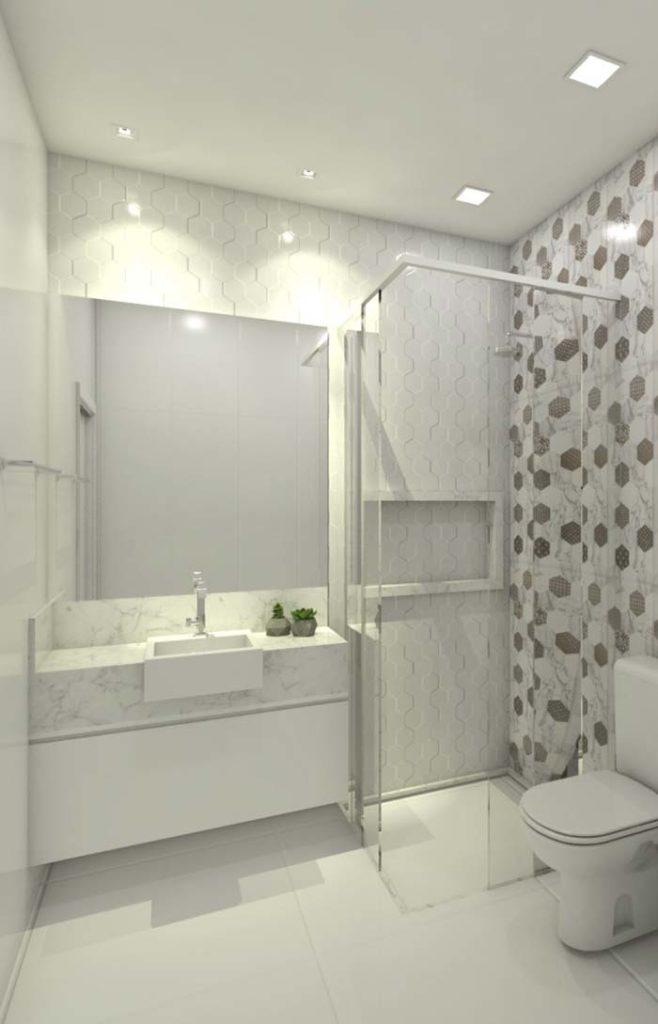 Banheiro pequeno com bancada de mármore branco calacatta.