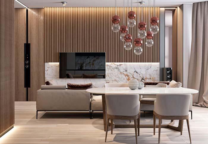 Sala luxuosa com painel de mármore paraná.