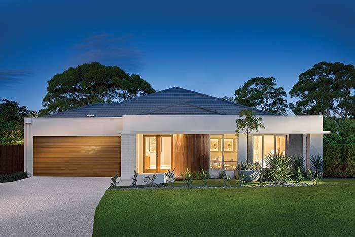 Tipos de telha: Casa térrea moderna com telhado de telhas de concreto.