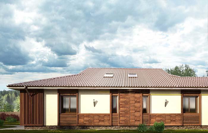 Tipos de telha: Casa de campo térrea com madeira e telhado com telhas de cerâmicas.