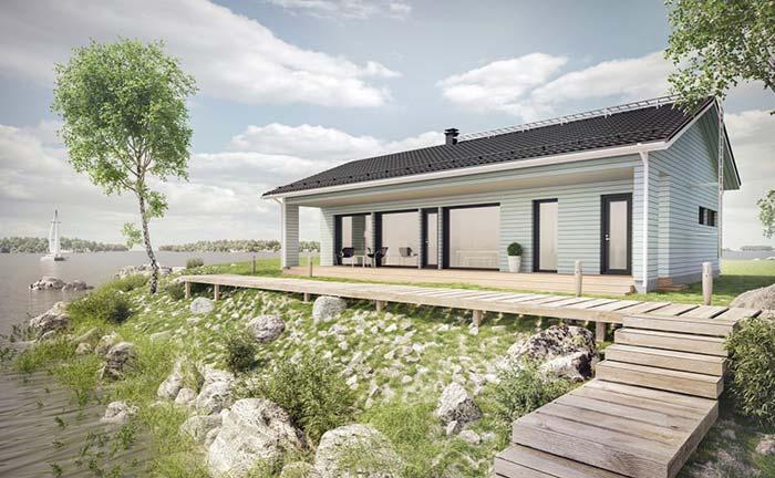 Casa de campo na beira do lago com telhado em duas águas com telhas esmaltadas.