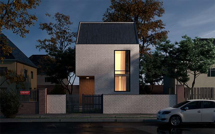 Casa moderna com parede de tijolinho aparente e telhado de fibrocimento.