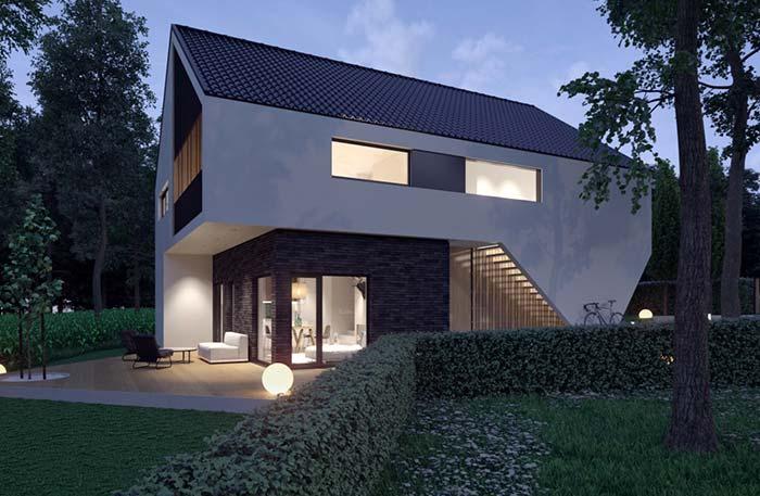 Casa moderna com parede de revestimento de pedra e telhas esmaltadas escuras.
