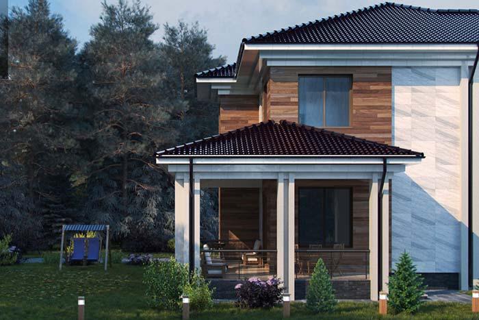 Casa luxuosa com telhado de telhas de cerâmica escuras.