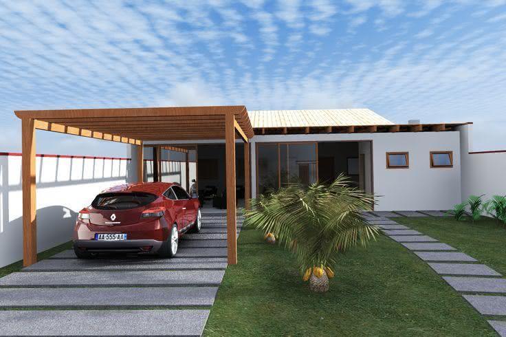 Casa moderna com estrutura de madeira na área dos carros