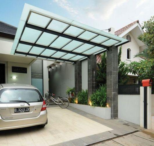 Cobertura moderna para garagem de vidro.