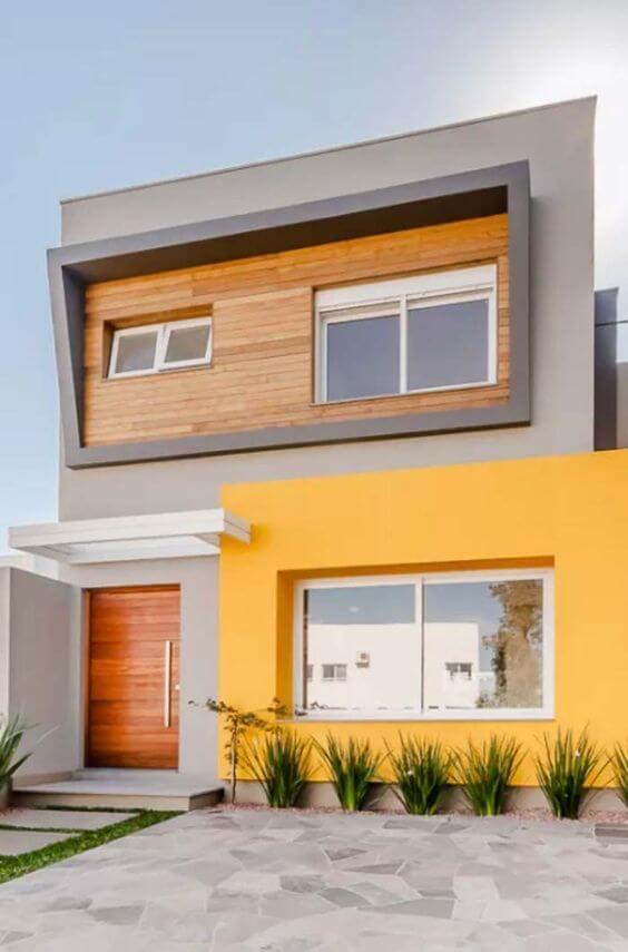 Cores de tintas para fachada de casa moderna e amarela.
