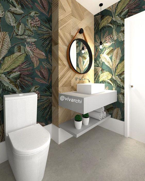 Papel de parede para banheiro com estampa de folhas.