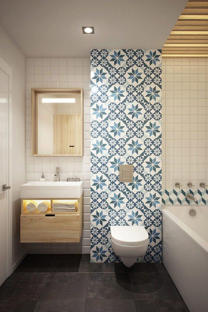 Papel de parede para banheiro com estampa de azulejo azul.