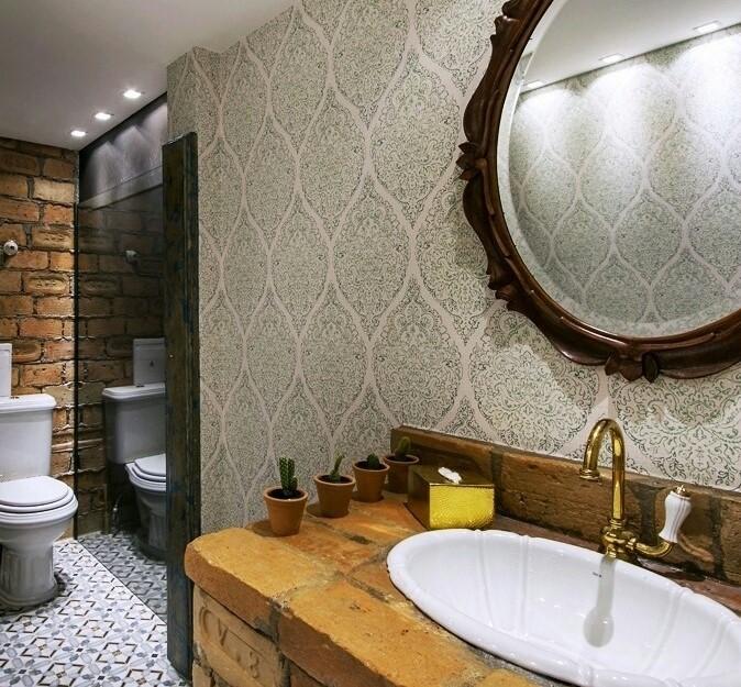 Papel de parede para banheiro com estampa verde.