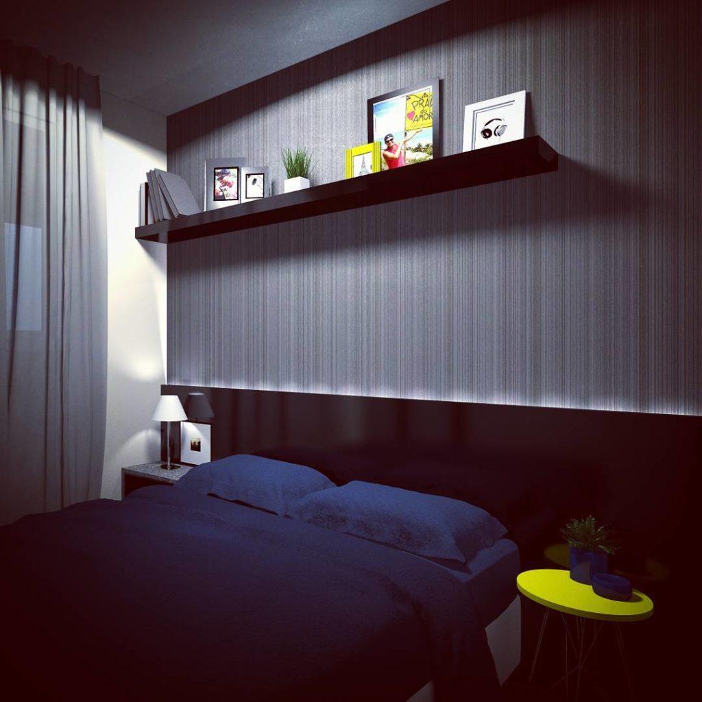 Decoração moderna e azul com cama de casal.