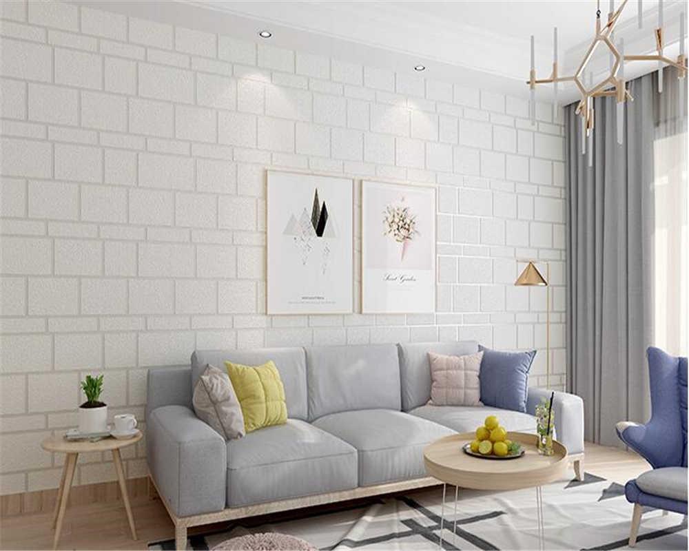Papel de parede para sala clean com sofá azul.