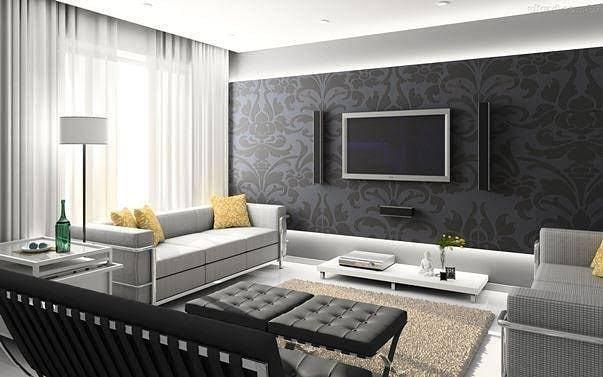 Decoração com parede preta e  sofá cinza.