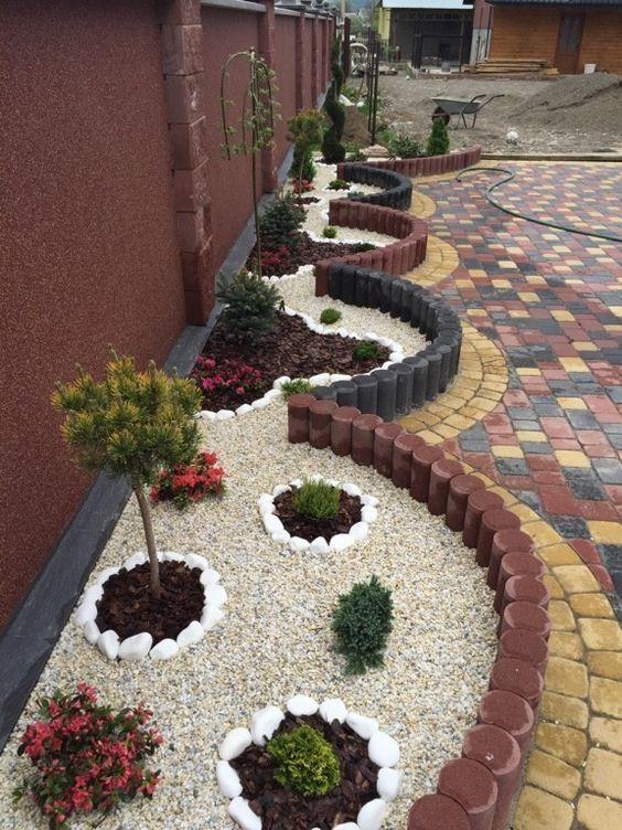Plantas para jardim decorado com pedras brancas.