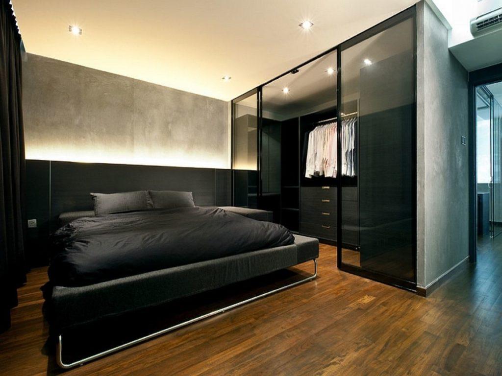 Quarto com closet preto.