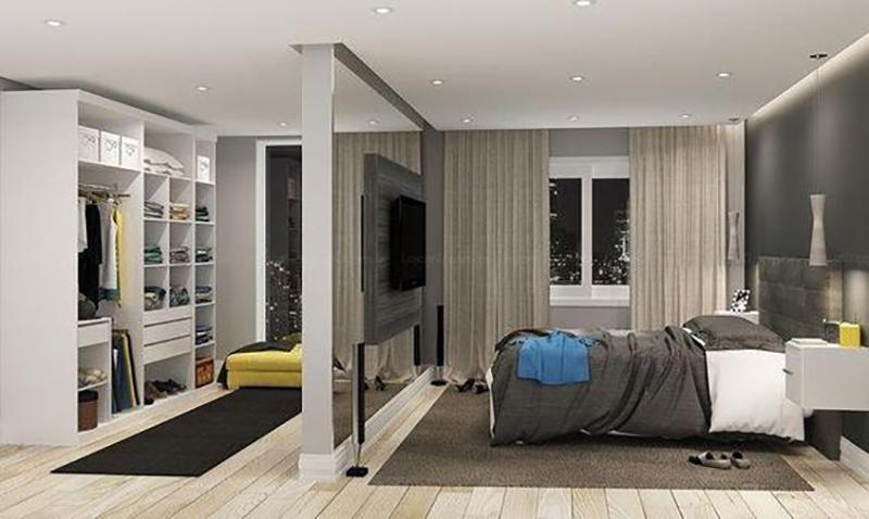 Quarto moderno com closet e spots de LED.