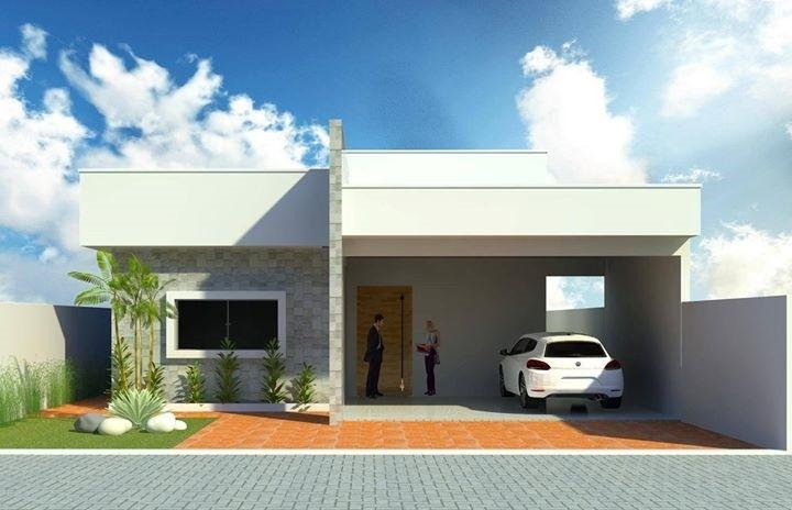 Casa térrea com telhado embutido simples.